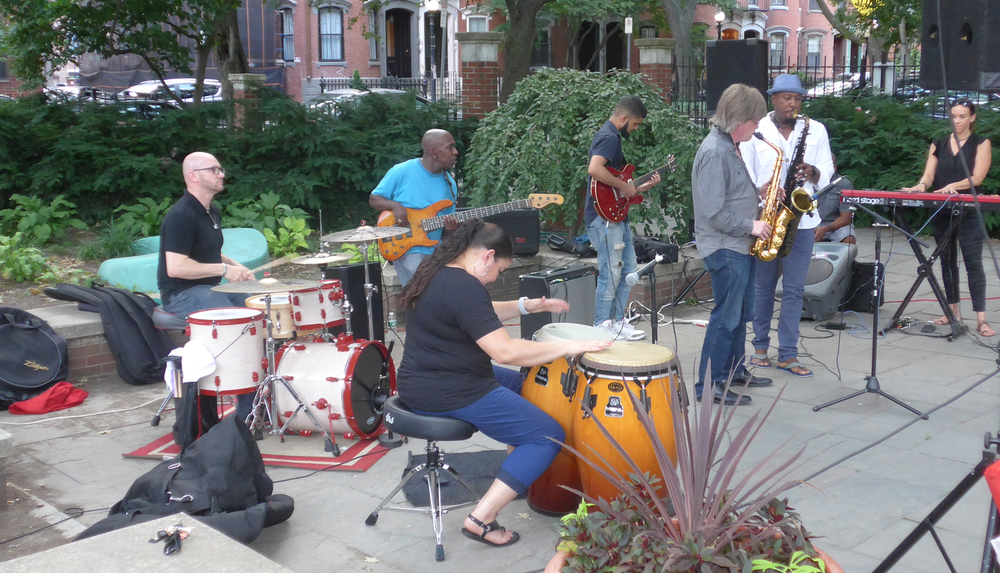 From left to right: Zeke Martin, drums; Daniel Day, bass; Zayra Pola Ocassio, percussion; Antonio Loomis, guitar; Pat Loomis, alto sax; and Elan Trotman, tenor sax.