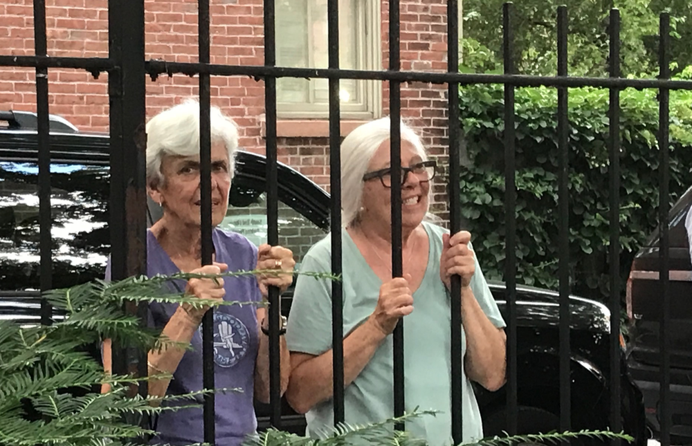 Happy neighbors on both sides of the fence at Library Park
