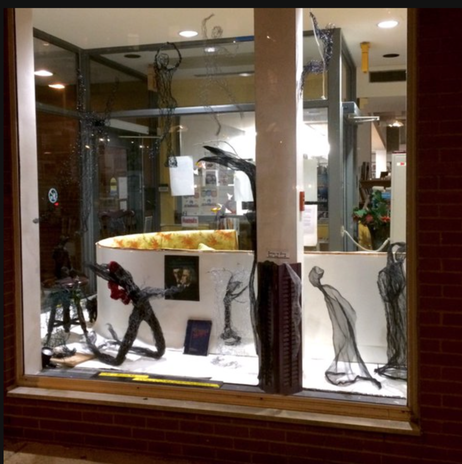 m The SE library's Tremont St window at night, with Will Corcoran's wire sculpture installation.