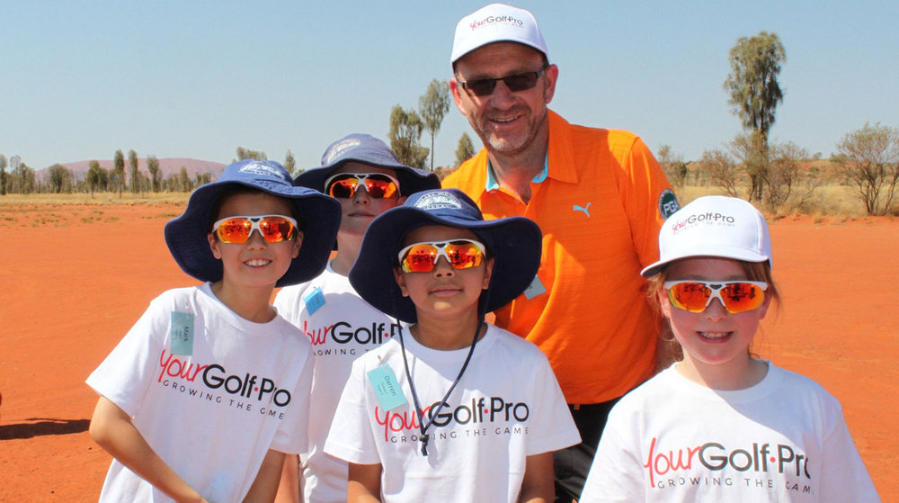 Golf Pro Marcus Liberman with Junior Group Lesson Class