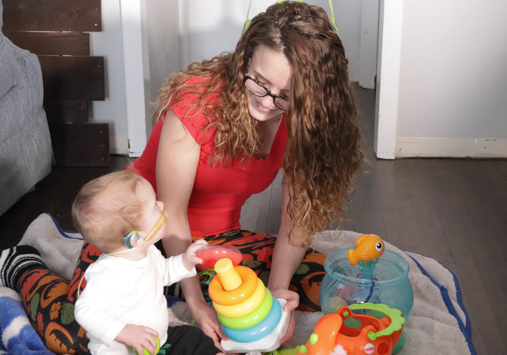 Macey Kinney plays with her 10-month-old son Zealand, who was born deaf. A new study shows that developmental differences in deaf babies extend beyond language and hearing, and begin surprisingly early in life. Credit: Ohio State University Wexner Medical Center