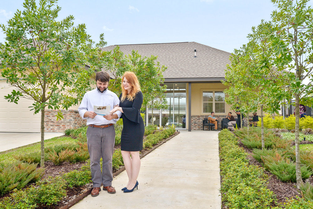 Olen and Katie enjoying the landscaping outside our welcome center