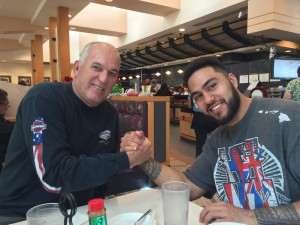 """Coach JJ with former UH standout QB Bryant Moniz, now with CFL Grey Cup champion Calagary. JJ: """"You can play in the NFL right now."""""""