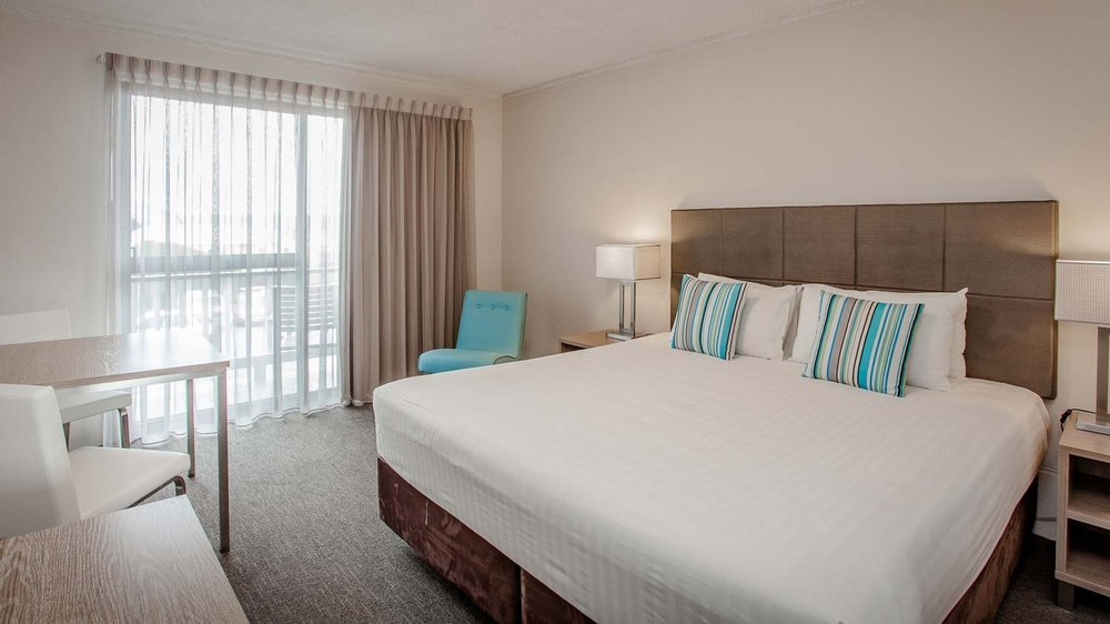 Executive King - Spacious room with a King bed and private balcony.