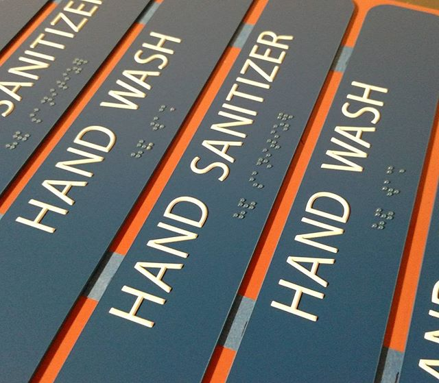 ADA signs have become simple and more beautiful. We love our printed dimensional ink!  White ink text with clear ink Braille.