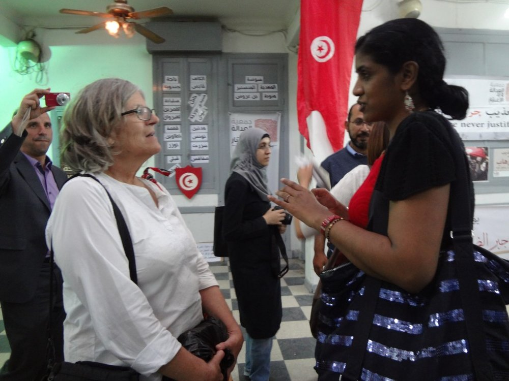Workshop participants visited the headquarters of the previous ruling party, the basement of which was used as a prison. It is now a center for human rights. Shown here are Ereshnee Naidu (right), from the Coalition of Sites of Conscience, and Shirley Gunn (left), from the Human Rights Media Center in South Africa.