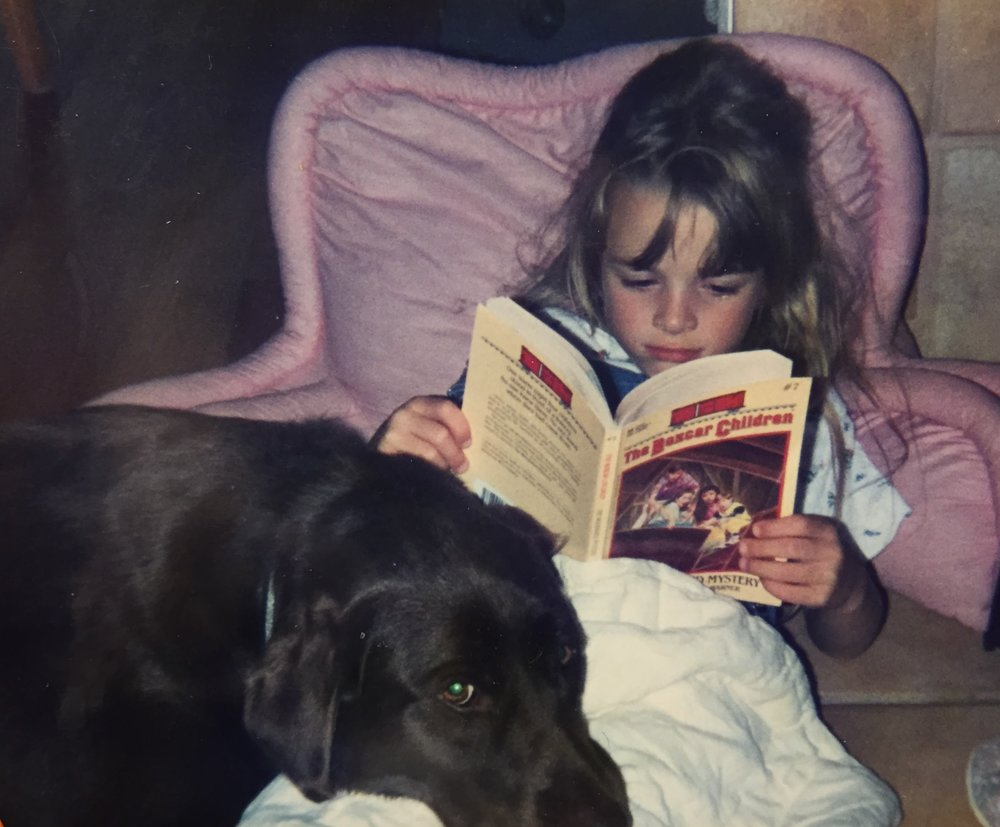 Me reading with Fudge, circa 1995.