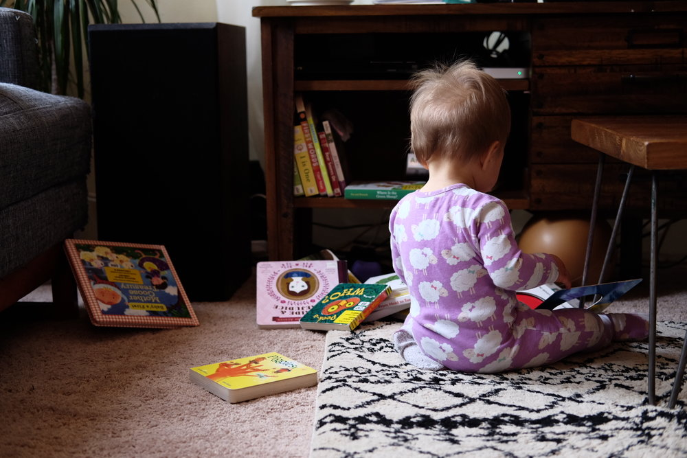 Ella (about 1 year old) and her board books.