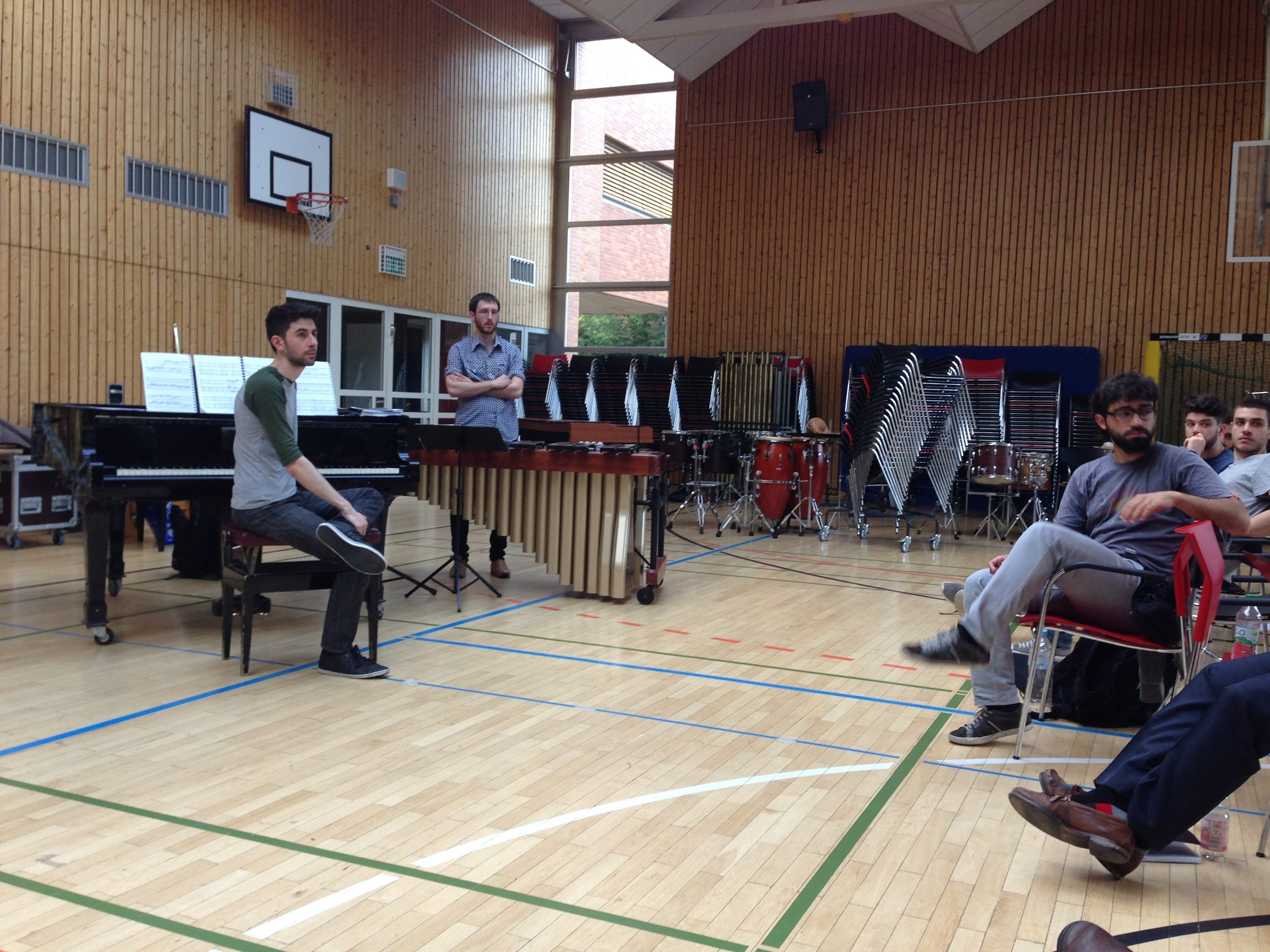 Alex and Angus receive coaching from composer Georges Aperghis and percussionist Christian Dierstein during a masterclass at the Darmstadt Summer Festival.