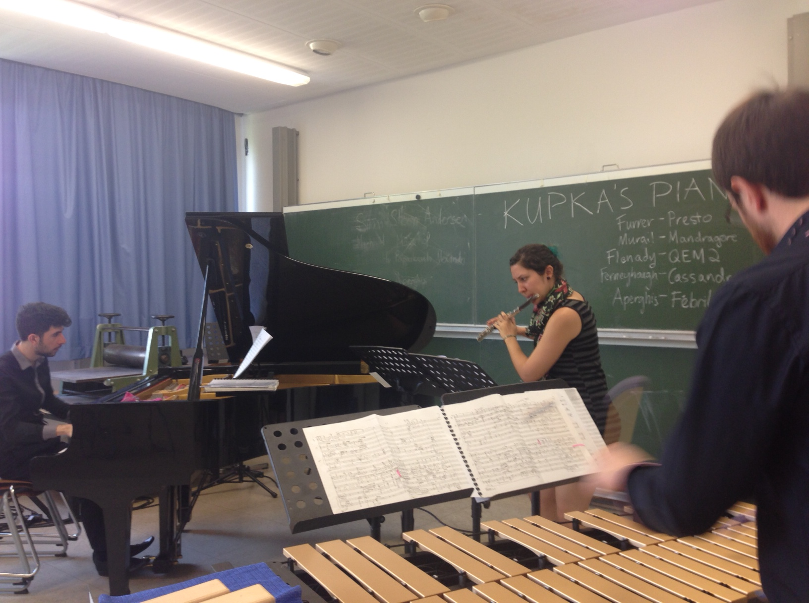 Alex, Hannah, and Angus perform Liam's 'Quite Early Morning' in an 'Open Space' workshop at Darmstadt.
