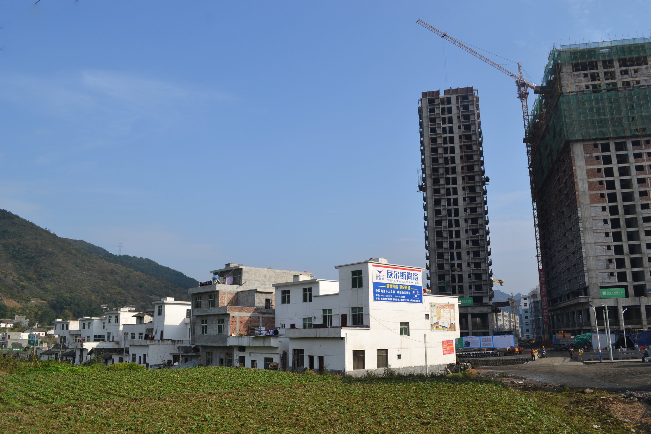 New apartments rise from the fields in Qiyan, Sha'anxi province