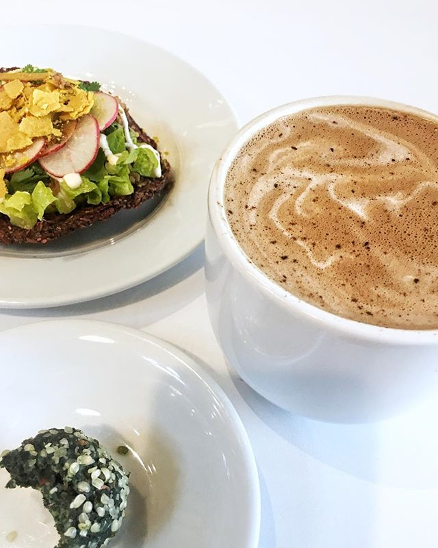 "It's been a hot minute since I've posted. 😅 Been spending most of my days trying to get my life together (update: still a work in progress) while running on not enough sleep, drinking copious amounts of coffee & listening to podcasts. 💁🏻‍♀️ - This morning I treated myself to an adaptogenic latte ☕️, a raw vegan tostada 🌱 & a superfood ""dohnut""🍩. That tostada though, in all its meat-less, grain-free, dairy-free uncooked glory, was hella good. #tostadatuesday on a Wednesday, heyyyy! - Hope everyone's having a productive week! We got this! 💪🏼 #polkadotrum"