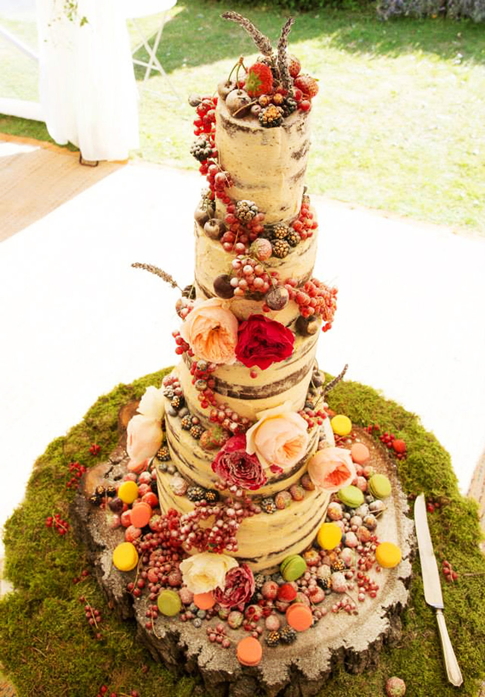 Woodland Wedding Botanical Cake - This is our super showstopper botanical wedding cake. Up to five tiers of delicious cake flavours styled with fresh buttercream & adorned with piles & piles of fresh fruits & berries. Why not serve it as dessert for your big day along side a hefty scoop of ice cream & more crisp berries?
