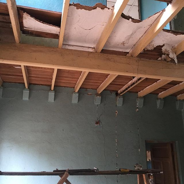 "How do you finish the soffit of a wooden floor that has seen better days, undergone several (good and bad) ""facelifts"" in the past and is probably as old as your parents? Cover it? ...............🤔 Nah! We chose to leave it's complex, dazzling beauty exposed.  #ceilings #woodenfloorsoffit #restoration #vintage #homes #architecture #kaduna #Nigeria #agstudioltd #avantgardestudio"