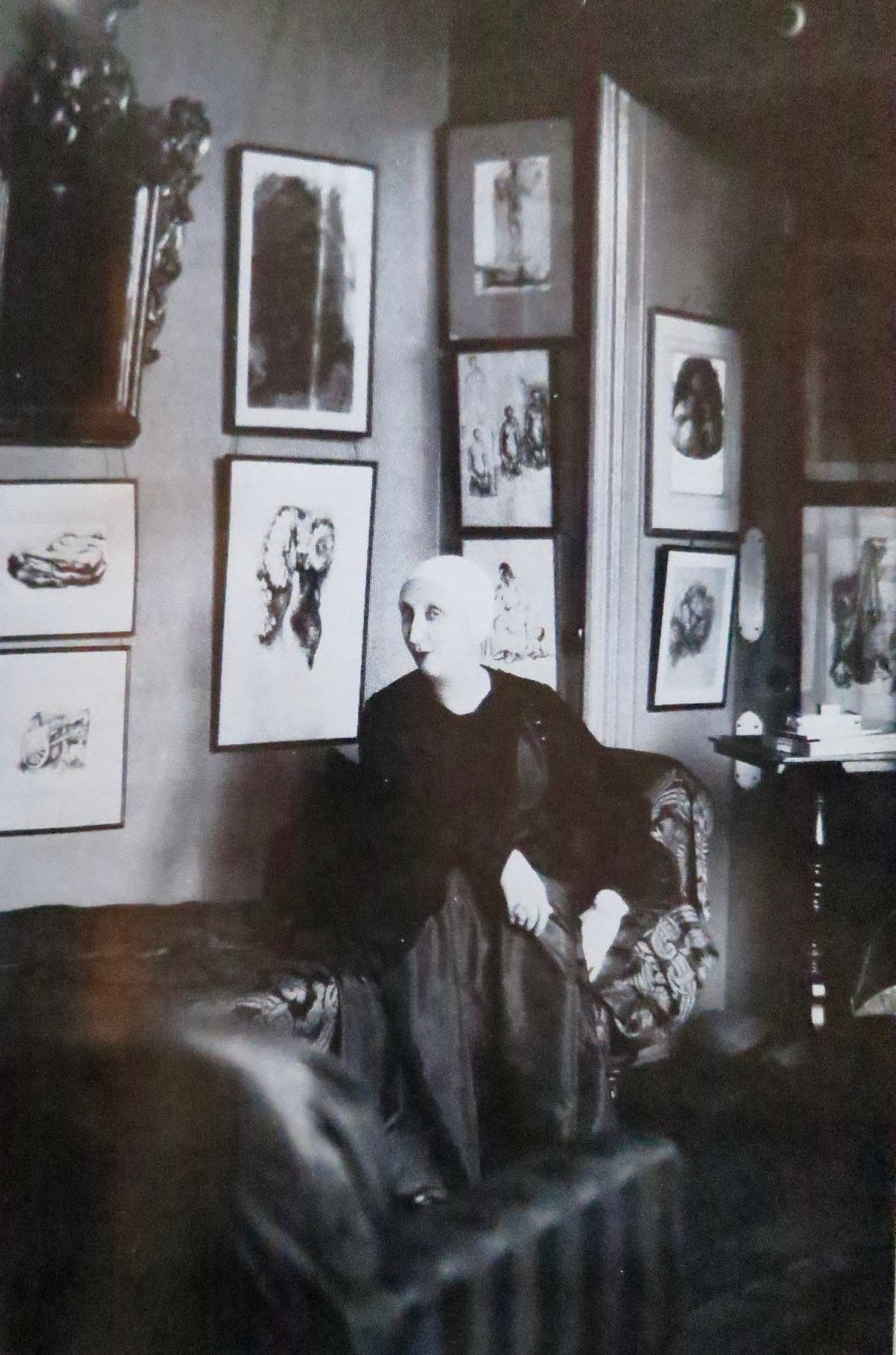 Edith Sitwell in Pembridge Mansions 1930 with pictures by Pavel Tchelitchew on the wall.