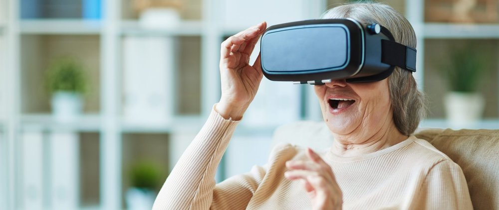 Older-woman-using-oculus-rift-virtual-reality-headset-for-health.jpeg