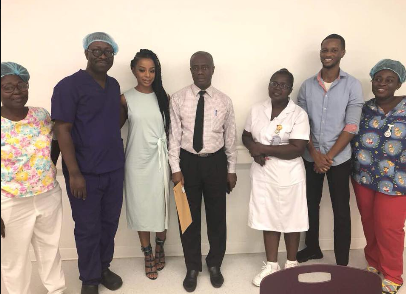 Pictured alongside Dr. Pobee (blue scrubs) and the Ridge Hospital maternity ward staff and James (blue shirt) of CocoRide GH