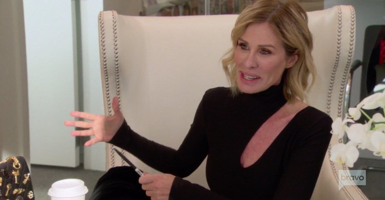 Carole-Radziwill-Black-Cut-Out-Blouse-RHONY.jpg