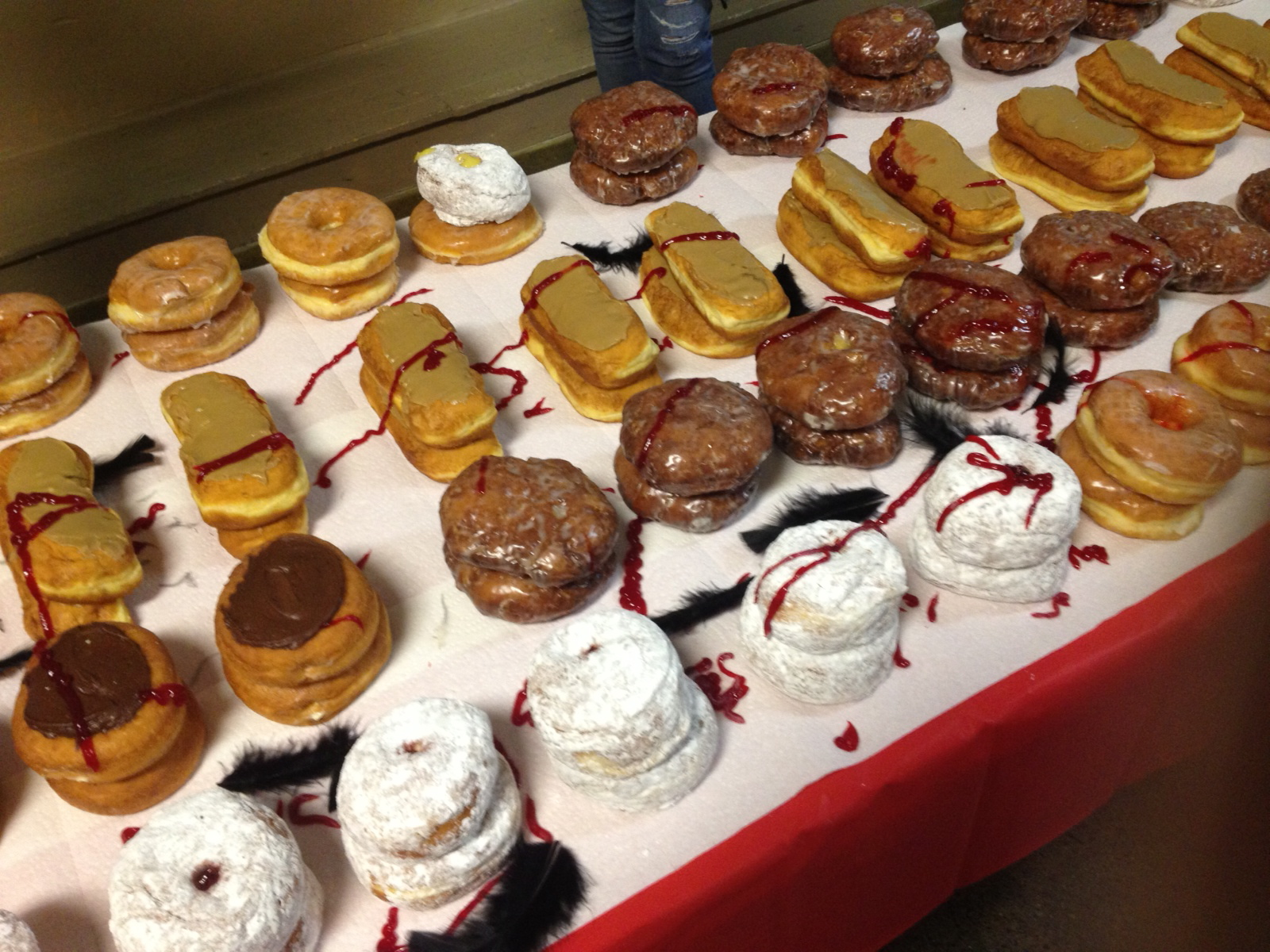 Donuts galore covered with Waldo's shattered remains -- feathers and jam.