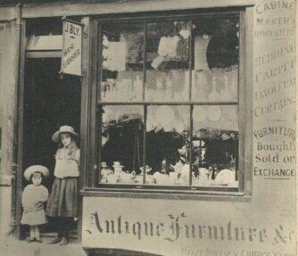 Frank John Bly and sister Doris Bly at John Bly's Shop 22 High Street, Tring. c 1908