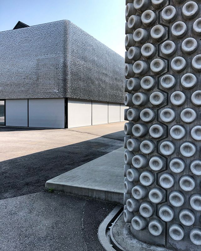 "An amazing visit to the Bischofberger gallery compound in Zurich. A series of industrial buildings were completely gutted and imaginatively resurfaced by Baier Bischofberger Architects to house gallery and collecting activities. One building is covered in pre-cast concrete panels with octopus suction cup-like pattern, while another has a ""soft"" skin composed interlocking metal ""fingers"" (first photo). The whole complex is an architectural revelation of light, material, and details. @baierbischofberger @ninabaierbischofberger"