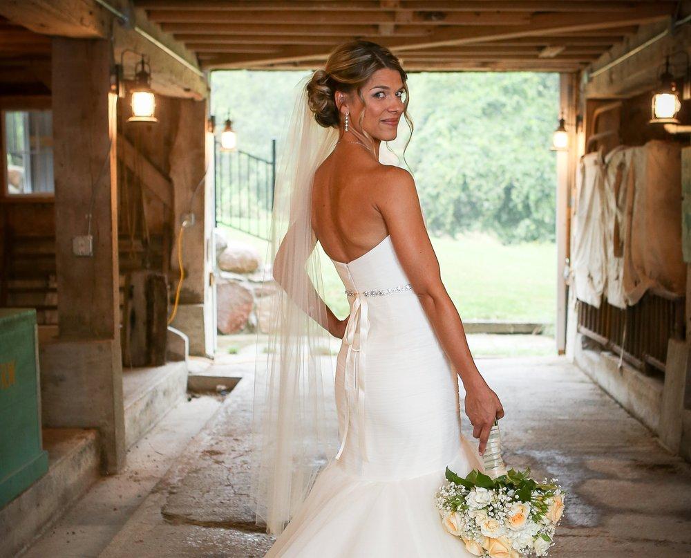 Kokomo, Indiana wedding barn photography of bride with rustic barnwood and carriage lights