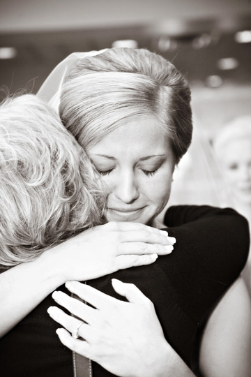 Emotional embrace of a Bride and her Mother