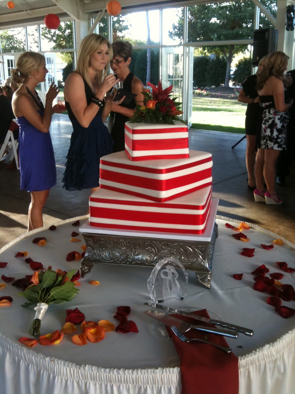 Square Wedding Cake offset with Red & White Ribbon