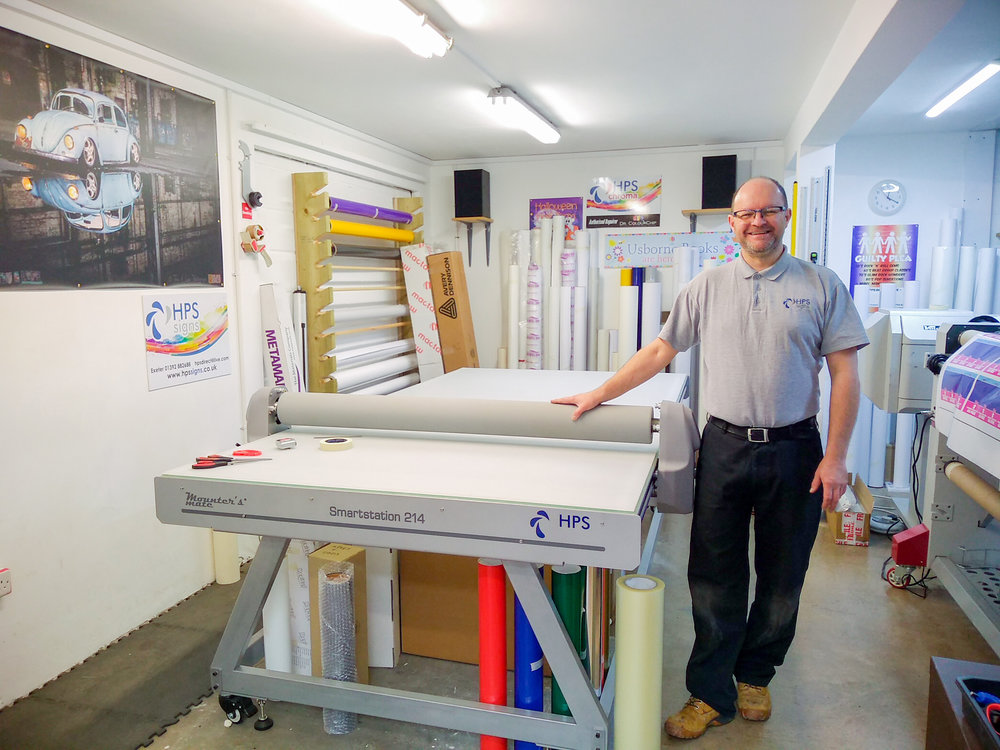 """It's allowed me to take on jobs I probably would have had to turn away before."" Mark Andrews, owner of HPS Signs in Exeter, is enthusiastic about his Mounter's Mate Smartstation flatbed mounting table. ""It just allows you to say 'yes I can do that,' rather than not being sure, or it taking twice as long!"" - Mark, HPS Signs"