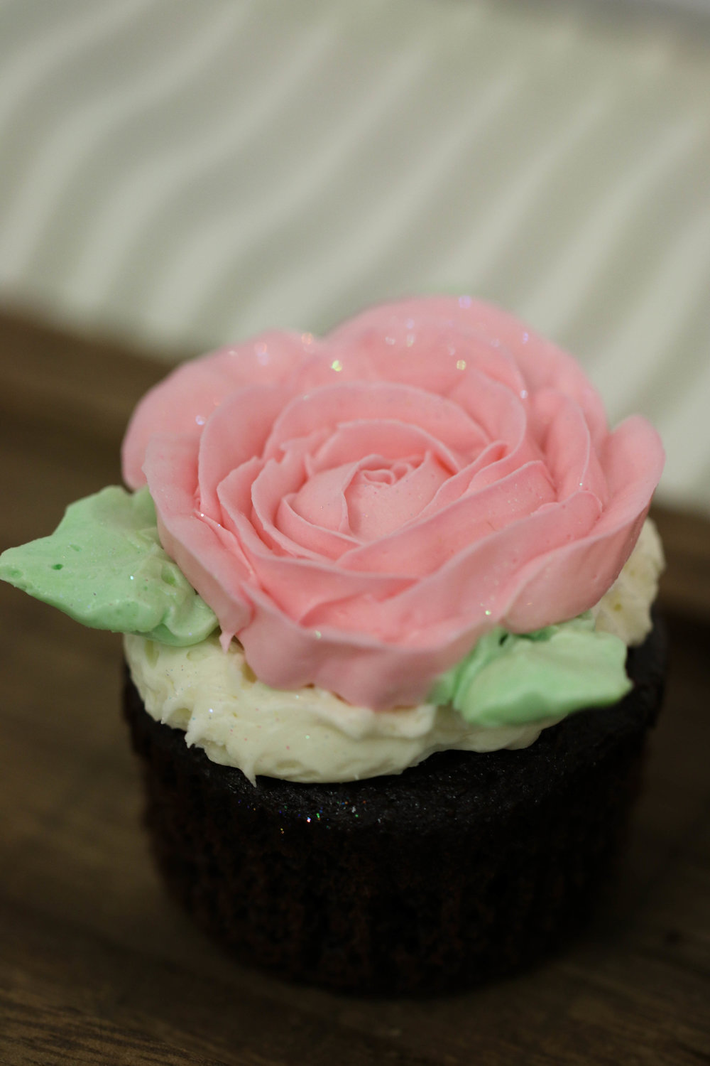 Decorated white cupcake with buttercream frosting