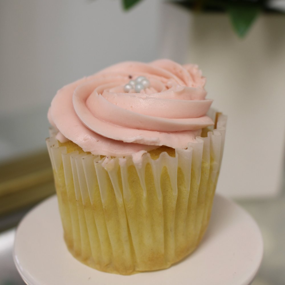 White Cupcake with Strawberry Buttercream Frosting