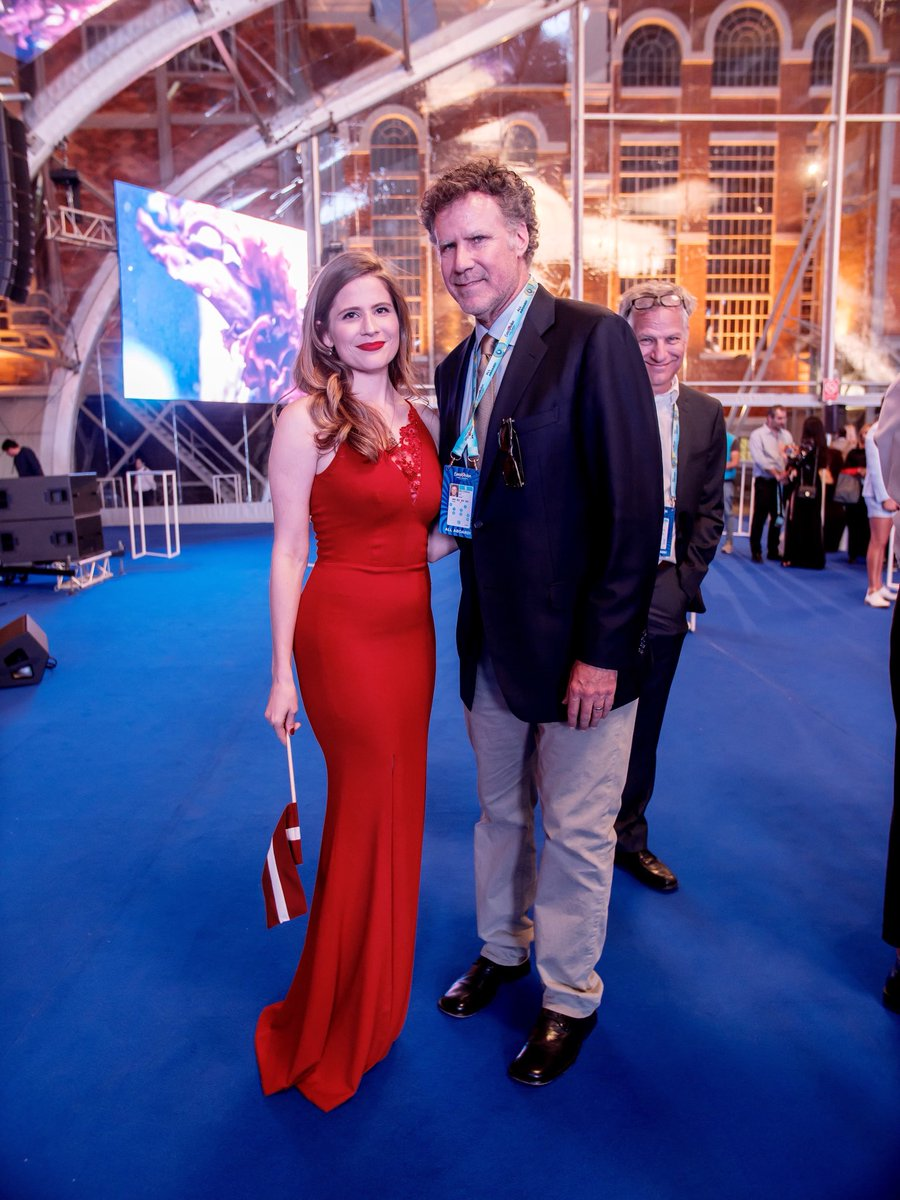 Will Ferrell posing with this year's Latvian representative singer Laura Rizzotto