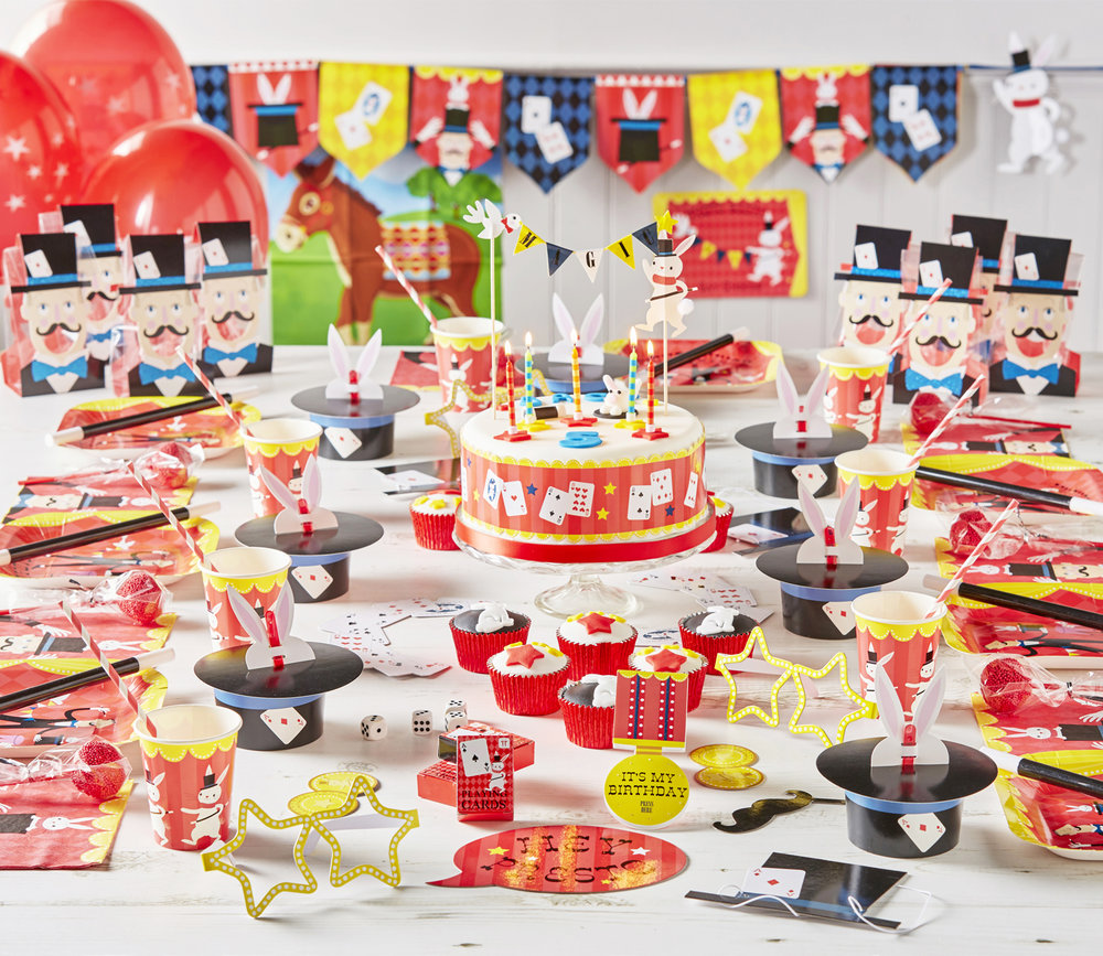 JACK's 5TH BIRTHDAY MAGIC PARTY This party is bursting with bright colours, a real feast for the eyes. A magician and his rabbit appear on all the tableware, but the rabbit ear treat cups have to be our favourite item, they are just too cute. Other party elements included bunting, balloons and photo booth props. Party favors for guests in cellophane treat bags included, a magic wand, pack of cards, fortune telling fish and dice, along with sweet treats. Jack's eyes really lit up when he saw his party for the first time, it seems we really had conjured up a magical party.