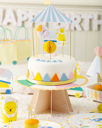 GRACE'S 1ST BIRTHDAY CIRCUS PARTY What lovely delicate pastel colours there are in this circus party, perfect for a little boy or girl. So many gorgeous features, including a circus train centrepiece to place snacks in, party hats in the style of a circus big top and circus animals including, elephants, seals, fish, giraffes and lions decorating the tableware. Polka dots, candy stripes and scalloped edges appear throughout the decorations and confetti filled balloons complete the look. A special celebration for a very special little girl.