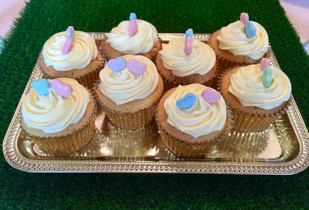 Gorgeous cupcakes served on silver trays of course.