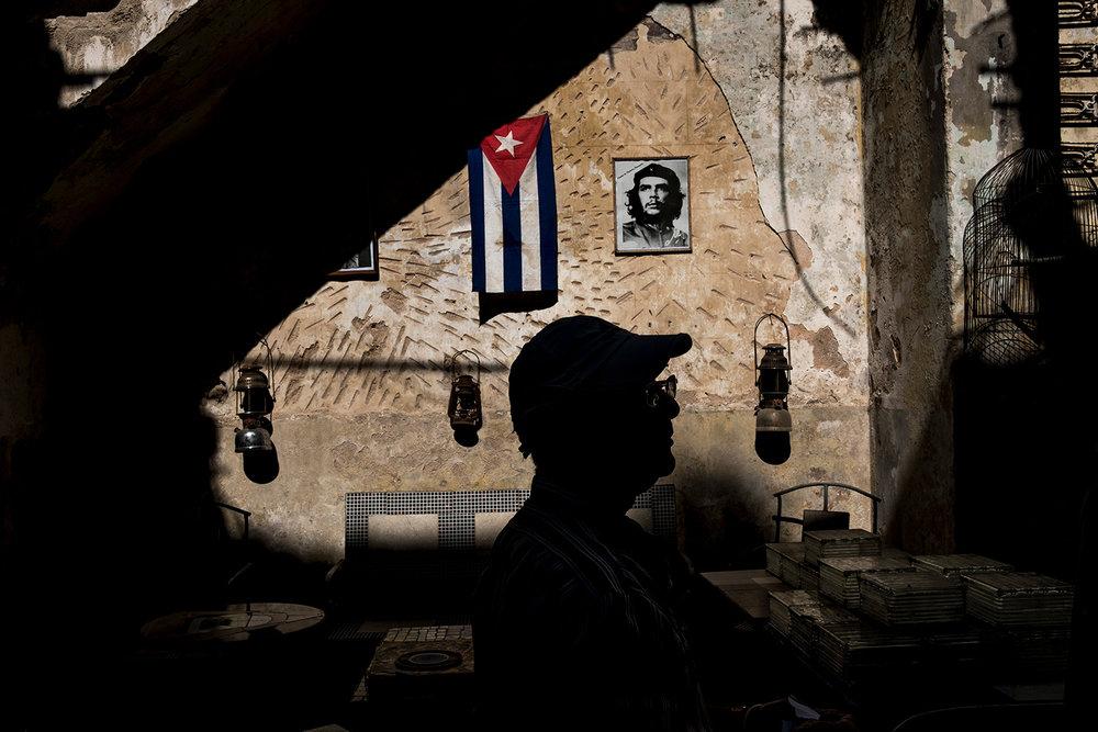A salesman is silhouetted in a local market in Havana, Cuba.