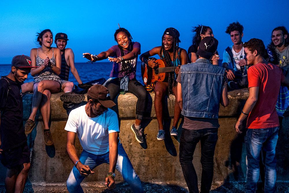Cubans drink and dance in Havana, Cuba.