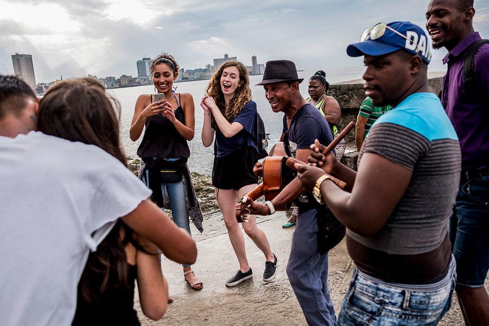 Cubans and tourists dance in Havana, Cuba.