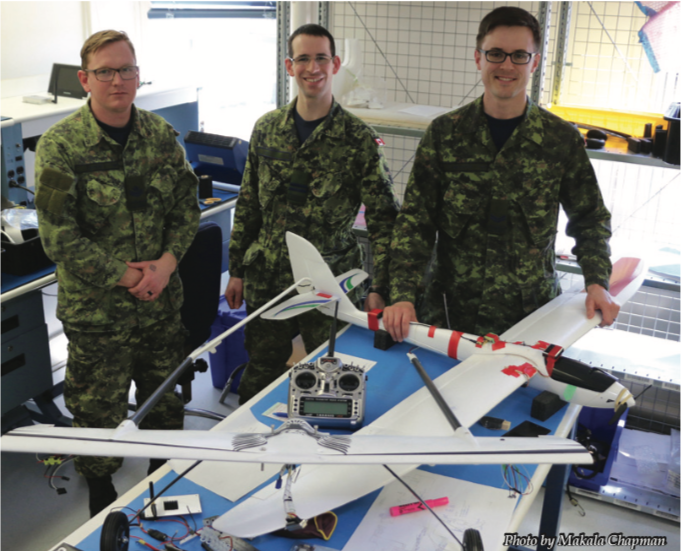 Master Corporal Greg Linton, Captain Dave Hardy and Corporal Stephen Hankinson with the Albatross UAV (foreground).