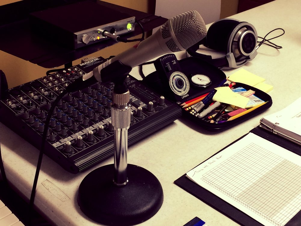Just a few of Matthew Culloton's producing tools: metronome; watch;pencils;microphone to communicate with the choir in the sound proof sanctuary; and, of course, the Holy Spirit Mass score.