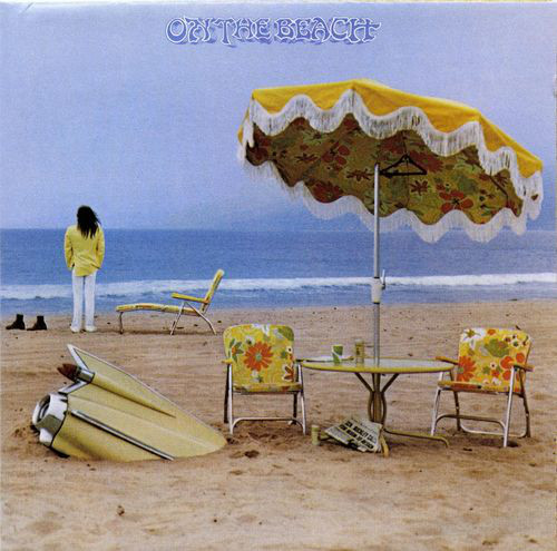 """Vinyl Pairing: Neil Young – On the Beach (1974) - Part of Young's ditch trilogy, On the Beach finds Neil dealing with the weight of fame (""""I need a crowd of people, but I can't face them day to day""""). Rather than following the same formula of """"Harvest,"""" his #1 record of 1972, Neil decided to head to a ditch where he'd """"find more interesting characters."""" This dark era was baffling at the time, but is now considered a career highlight. In particular, side 2 of On the Beach is perhaps the best side of any Neil record.Further Listening: Live at Massey Hall 1971 (2007); Neil Young & Crazy Horse - Sleeps With Angels (1994)"""