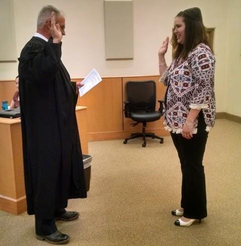 New CASA Volunteer Tiffany Holmes is sworn in by Judge Sweazea.