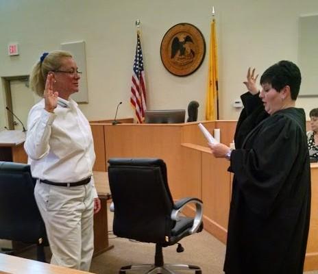 New CASA Volunteer Lisa Todd is sworn in by Judge Murphy.