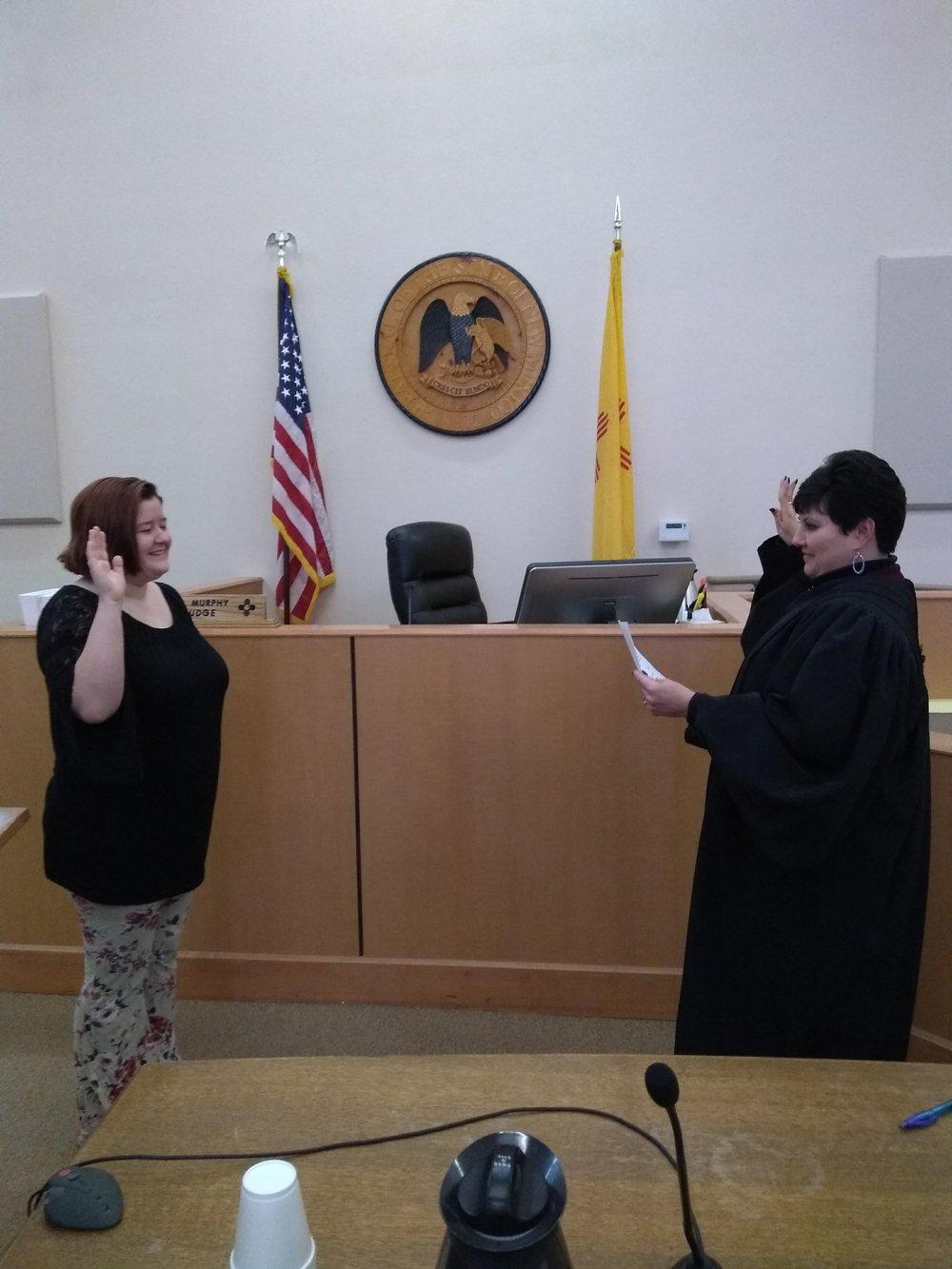 Volunteer Ariel Davis is sworn in by Judge Mercedes Murphy