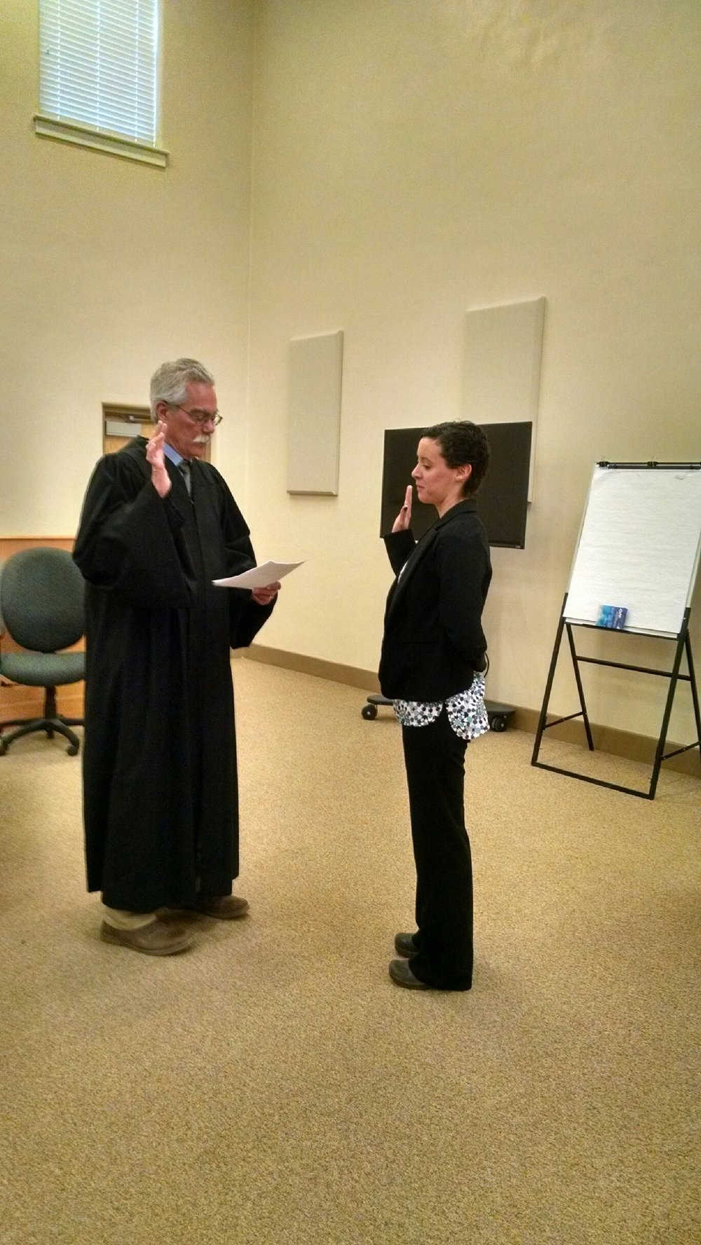 Volunteer Maria Weir is sworn in by Judge Matthew Reynolds.