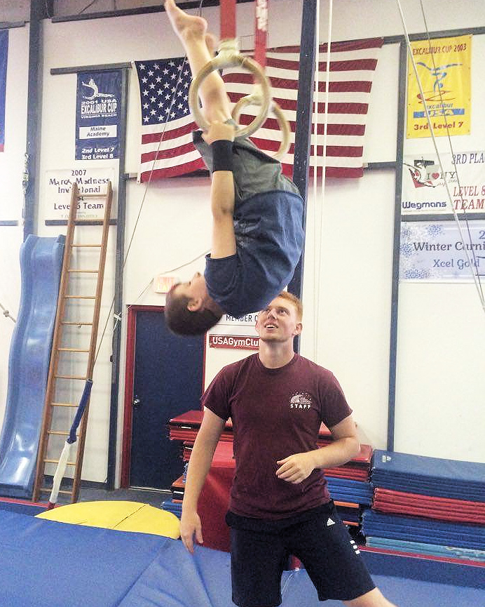 Coach Rigle w_ Ryan on Rings-MAG banner peterguyton.jpg