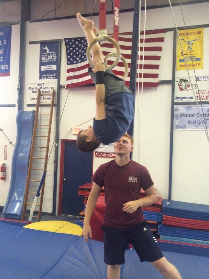 Coach Rigle w: Ryan on Rings.jpg
