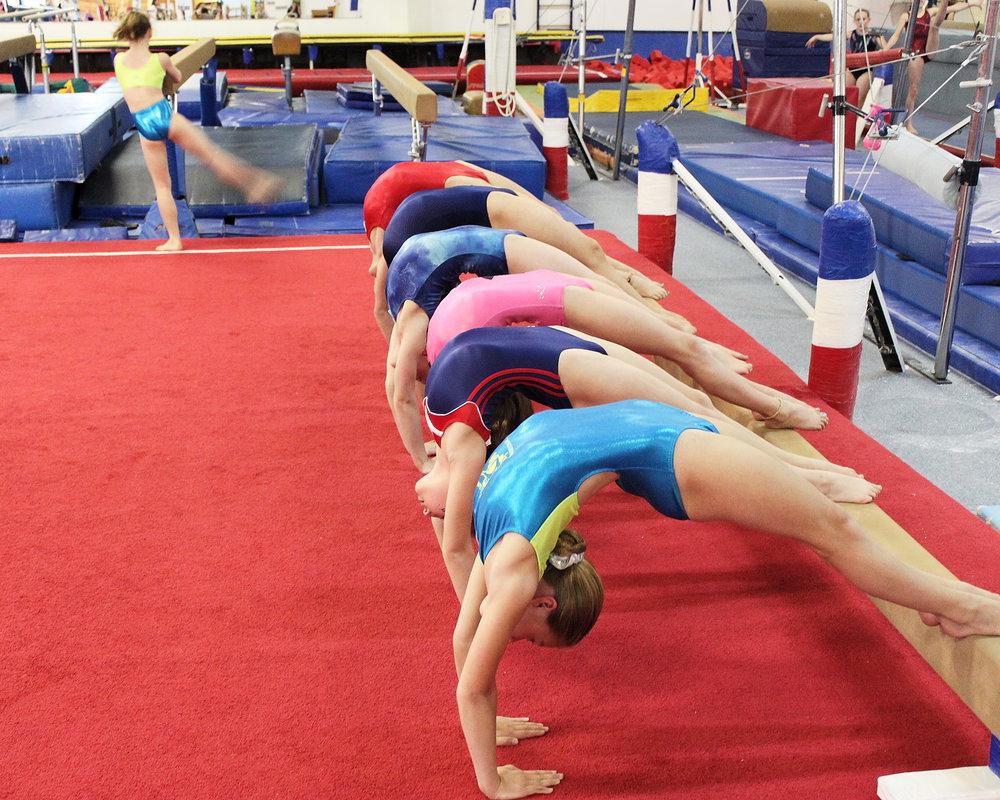 Team girls bridge stretch.jpg