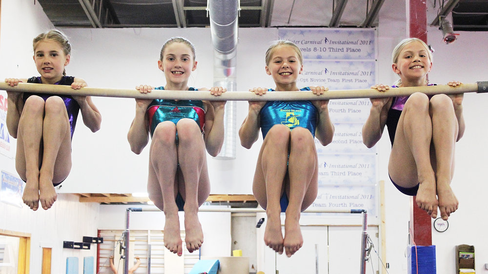 4 girls on a bar.jpg