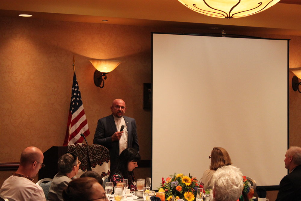Speeches, including Fr. Alex Schuter.